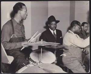 Count Basie orchestra practice, 1941. L to R: Jo Jones, Count Basie, Walter Page.
