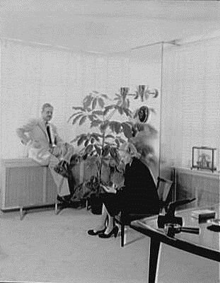 secretaryraymond loewy associates, 488 madison ave., new york city. mr. loewy at window and secretary taking dictation-crop